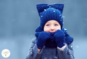 50082841 - cute little boy, kid in winter clothes walking under the snow