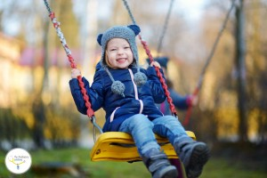 41806881 - adorable girl having fun on a swing on beautiful autumn day