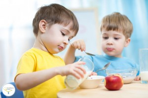 42593617 - children eating healthy food in kindergarten or nursery
