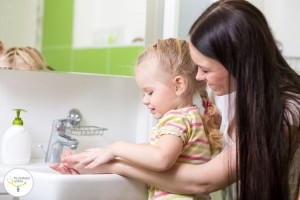38355178 - kid and mother washing hands with soap in bathroom